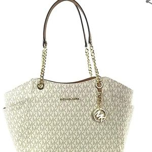 Michael Kors purse with gold handles